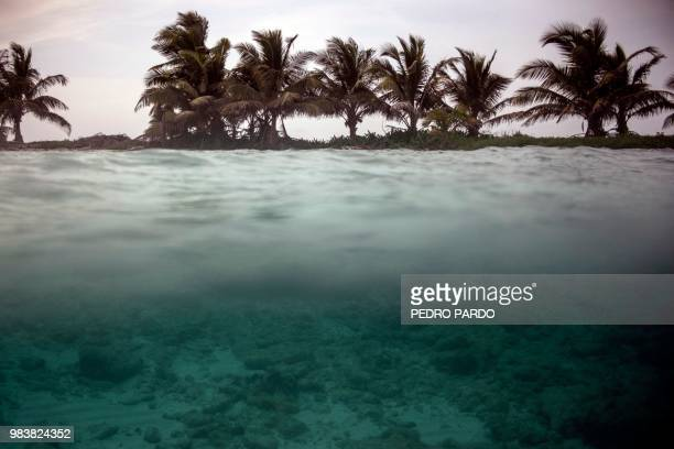 TOPSHOT View of the Laughing Bird Caye National Park in the outskirts of Placencia village in Stann Creek District Belize on June 6 2018 Backed by...