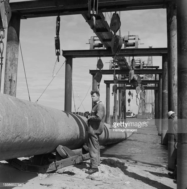 View of the launch of the North Coates pipeline, showing lifting equipment in the foreground. The civil engineering work on the North Coates oil...