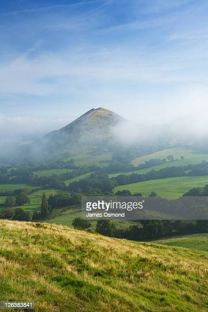 View of The Lawley in morning mist from Caer Caradoc, Shropshire, England, UK