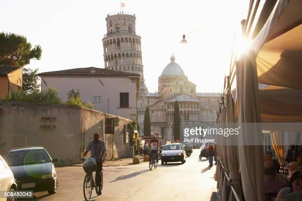 view of the leaning tower of pisa from city street, pisa, toscano, italy - pisa stockfoto's en -beelden
