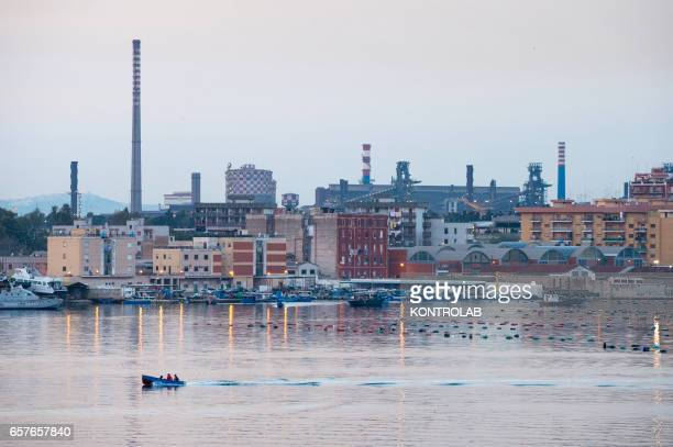 View of the left side of the Ilva factory in Taranto Tamburi behind the populous district Italian steel mill with the second largest settlement in...