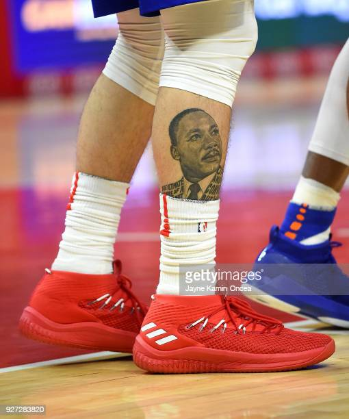 A view of the leg of Austin Rivers of the Los Angeles Clippers showing a Martin Luther King tattoo along with basketball sneakers he wore in the game...