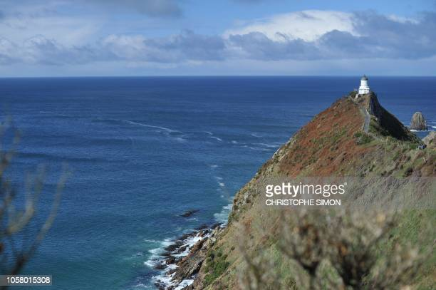 View of the light house of Nugget point in The Catlins on September 25 2011 AFP PHOTO / CHRISTOPHE SIMON