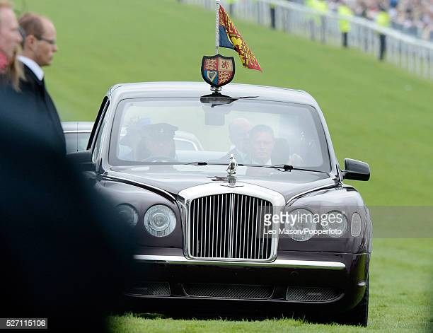 View of the limousine with Queen Elizabeth II arriving at the course for the Investec Derby Day Race Meeting at Epsom Downs in Surrey on the first...