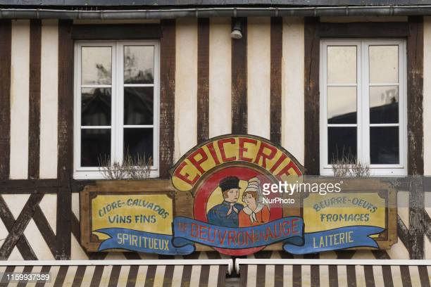 A view of the local grocery sign in BeuvronenAuge On Friday August 2 in Caen Normandy France
