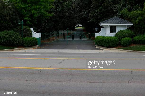 A view of the locked gates at the entrance of Magnolia Lane off Washington Road that leads to the clubhouse of Augusta National on March 30 2020 in...
