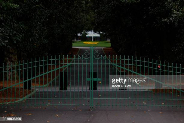 View of the locked gates at the entrance of Magnolia Lane off Washington Road that leads to the clubhouse of Augusta National on March 30, 2020 in...