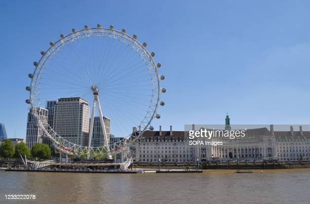 View of the London Eye with a clear blue sky as the heatwave continues in England.
