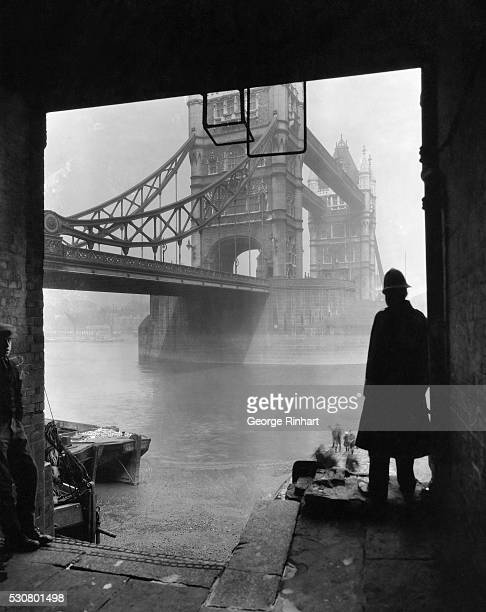 A view of the London Tower Bridge which looms softly through the mists and fogs of this great city