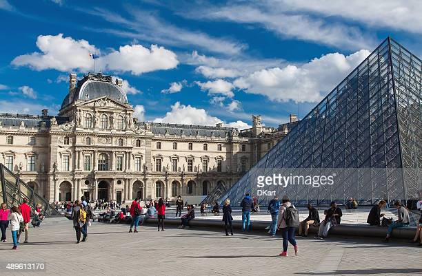 view of the louvre museum and pei€™s pyramid. - louvre pyramid stock photos and pictures
