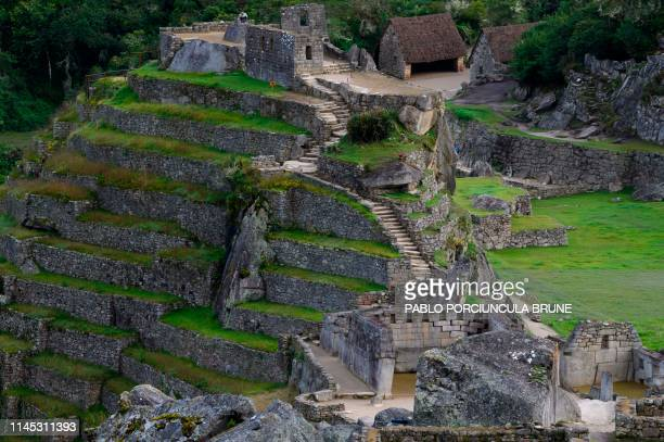 View of the Machu Picchu complex, the Inca fortress enclaved in the south eastern Andes of Peru on April 24, 2019.