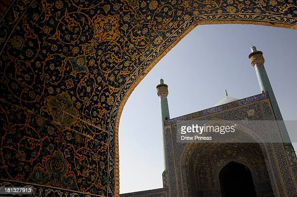 CONTENT] View of the main sanctuary entrance from blue and gold tiled North Iwan Imam Mosque on Imam Square Isfahan Iran