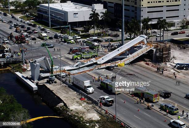 View of the main span of the FIUSweetwater UniversityCity Bridge after collapsing five days after been installed over SW 8 StreetState Road 41 on...