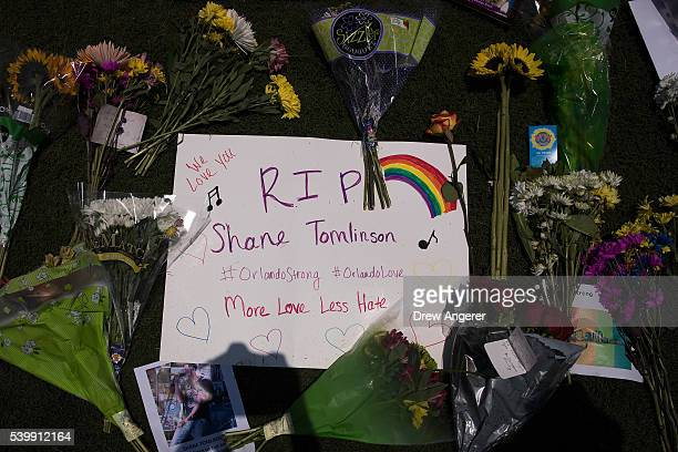 A view of the makeshift memorial for victims of the Pulse Nightclub shooting at Dr Phillips Center for the Performing Arts on June 13 2016 in Orlando...