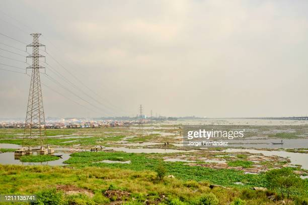 View of the Makoko suburb next to the Lagos lagoon from a highway bridge.