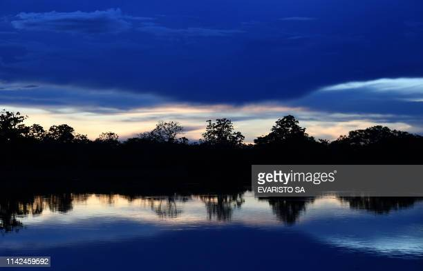 View of the Mamiraua River during sunset at the Mamiraua Reserve, Brazil's largest protected area, in Amazonas State, on April 24, 2019. - The...
