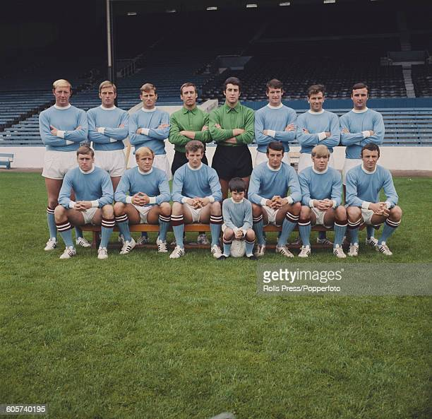 View of the Manchester City FC football team posed together on the pitch inside Maine Road stadium in Manchester in July 1968 at the start of the...