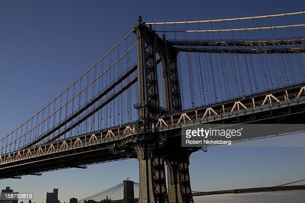 A view of the Manhattan Bridge December 23 2012 from the FDR Drive along the East River in the Manhattan borough of New York The Manhattan Bridge is...