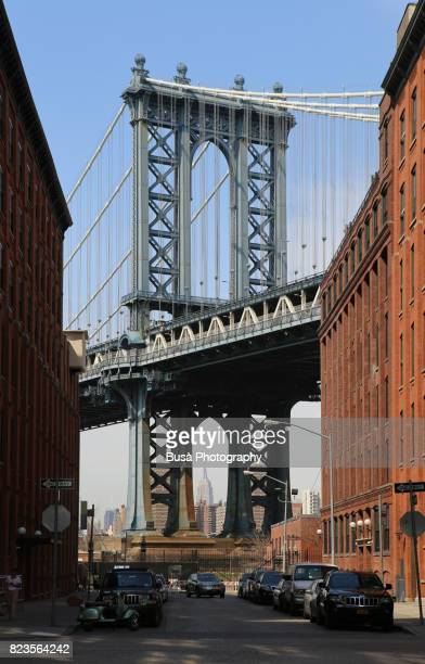 view of the manhattan bridge from washington street in dumbo, brooklyn, new york city - international landmark stock pictures, royalty-free photos & images