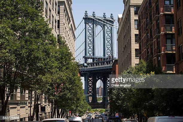 A view of the Manhattan Bridge in the DUMBO neighborhood on June 24 2016 in the Brooklyn borough of New York City According to a survey released on...