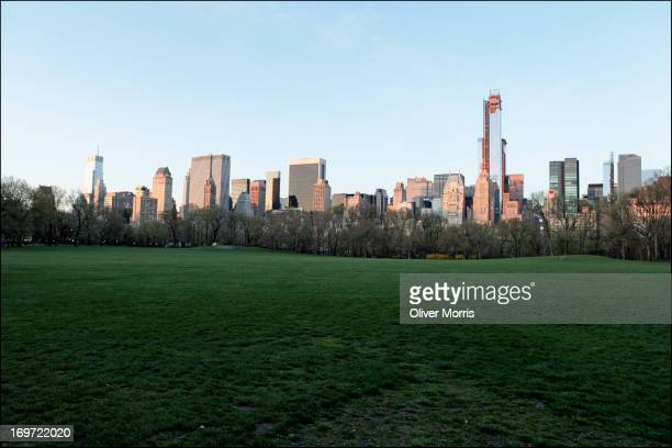 View of the Manhattan skyline as seen from Sheep Meadow in Central Park New York New York April 21 2013 The 842acre public park was designed by...
