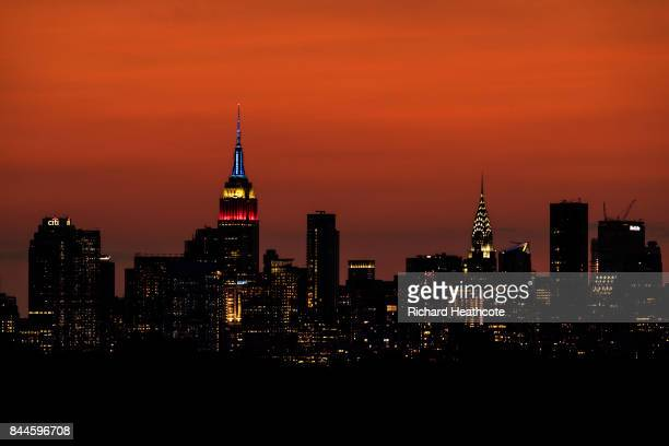 View of the Manhattan skyline including the Empire State Building and the Chrysler Building at sunset as seen from the Arthur Ashe Stadium on...