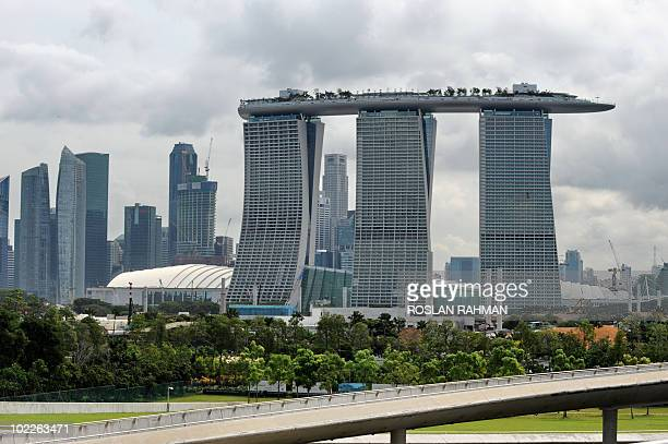 View of the Marina Bay Sands hotels with its Skypark on top in Singapore on June 21, 2010. The Marina Bay Sands Skypark will open to public as part...