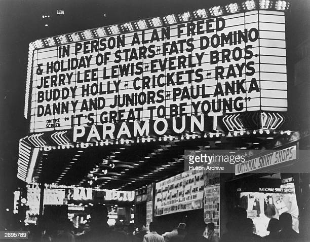 View of the marquee at the Paramount Theater New York City The sign advertises Alan Freed's 'Holiday of Stars' featuring rock roll performers Fats...