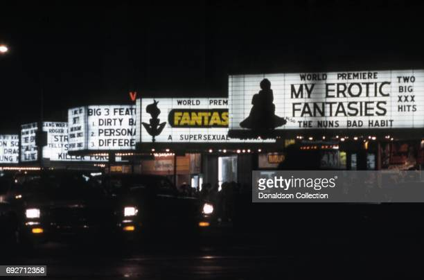 View of the marquees of cinemas on West 42nd Street including the RialtoII, the Rialto, the Victory Theatre, the Lyric Theatre and the Times Square...
