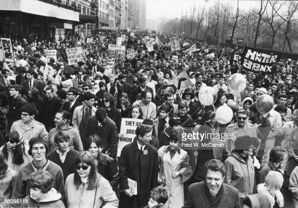 View of the massive crowd as it marches from Central Park towards United Nations Plaza as part of an antiVietnam War demonstration New York New York...