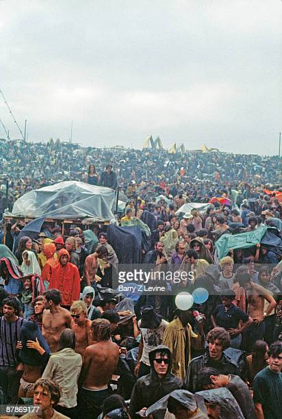 View of the massive crowd as they stand in the rain at the Woodstock Music and Arts Fair in Bethel New York August 15 17 1969