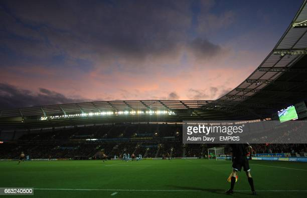 View of the match action inside the Kingston Communications Stadium at dusk