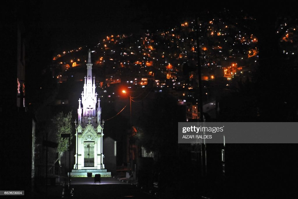 View of the mausoleum of the Ascarrunz family -one of the most taditional families in La Paz-- at the Municipal cemetery in La Paz, on October 31, 2011, on the eve of All Saints Day. For the first time, the mayor's office opened the cemetery by night to promote it as a tourist point and counteract the growing influence --mainly on residential neighbourhoods-- of Halloween celebrations. AFP PHOTO/Aizar RALDES /