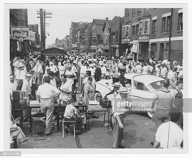 View of the Maxwell Street Market, looking west on Maxwell Street from Jefferson Street, Chicago, Illinois, August 14, 1955.