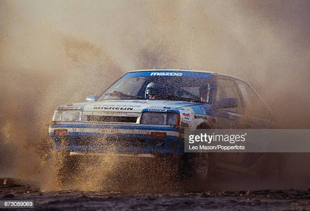 View of the Mazda 323 4WD rally car of the Mazda Rally Team Europe team driven by Finnish rally driver Timo Salonen with co driver and navigator...
