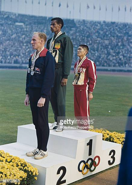 View of the medal ceremony for the men's marathon event, held at the 1964 Summer Olympics in Tokyo, Japan on 21st October 1964 with gold medallist...