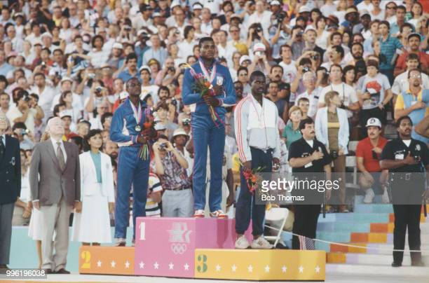View of the medal winners from the Men's 100 metres event with, from left, silver medallist Sam Graddy of United States, gold medallist Carl Lewis of...