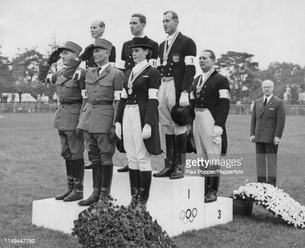 View of the medal winners from the team dressage Equestrian event with from left silver medallists Henri Chammartin Gustav Fischer and Marianne...