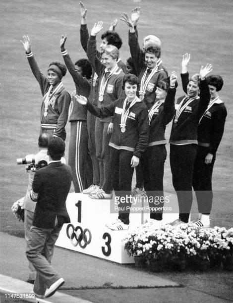 View of the medal winners from the Women's 4 x 100 metres relay event with from left silver medallists Willye White Wyomia Tyus Marilyn White and...