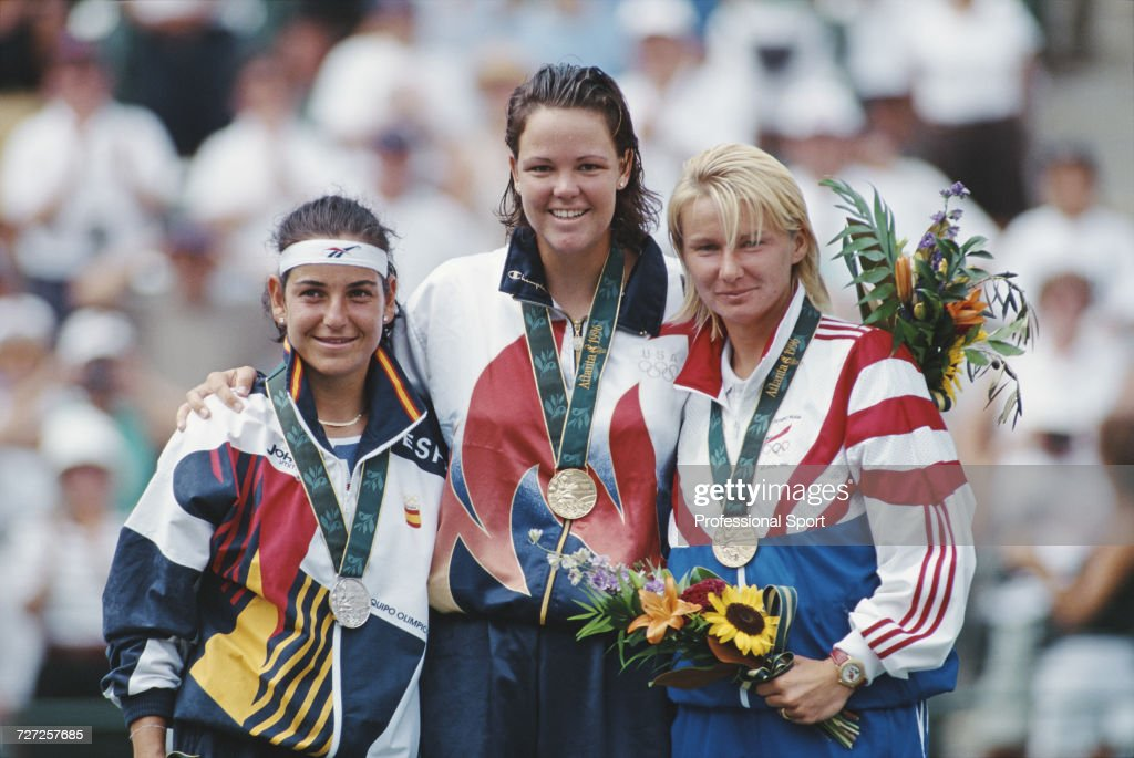 View of the medal winners in the Women's singles tennis event, from left, silver medallist Arantxa Sanchez Vicario of Spain, gold medallist Lindsay Davenport of United States and bronze medallist Jana Novotna of Czech Republic, pictured together on the medal podium at Stone Moutain Tennis Center in Stone Mountain, Georgia during the 1996 Summer Olympics in Atlanta, United States on 2nd August 1996.