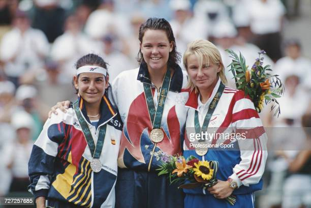 View of the medal winners in the Women's singles tennis event from left silver medallist Arantxa Sanchez Vicario of Spain gold medallist Lindsay...
