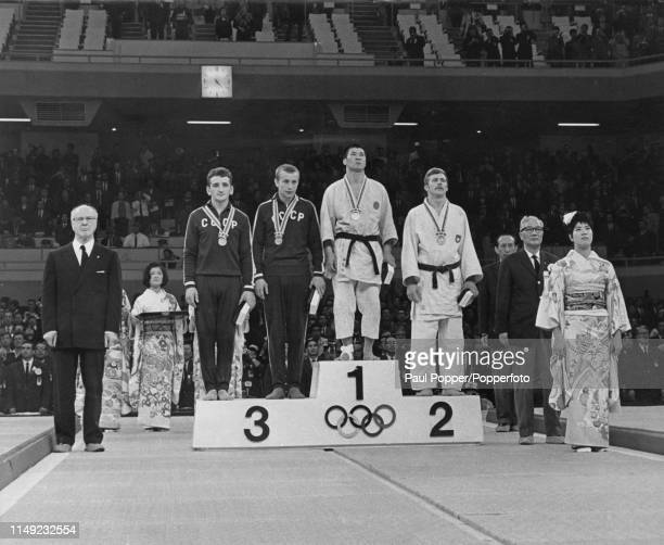 View of the medal winners of the Men's 68kg lightweight judo event with, from left, joint bronze medal winners Oleg Stepanov and Arons Bogolubovs of...