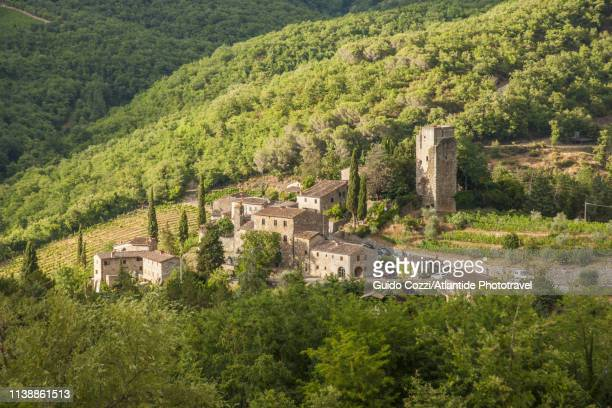 view of the medieval village and castle of vertine - image stock-fotos und bilder