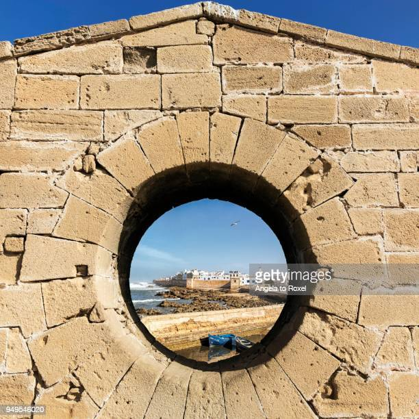 View of the Medina of Essaouira through the wall of the Skala du Port Fortress, UNESCO World Heritage Site, Essaouira, Morocco