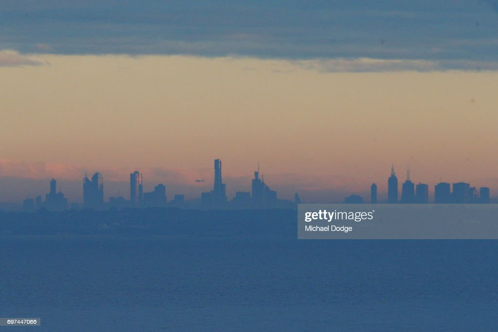 A view of the Melbourne city skyline is seen from Olivers Hill in Frankston as fog slowly clears during sunrise on June 19, 2017 in Melbourne, Australia.
