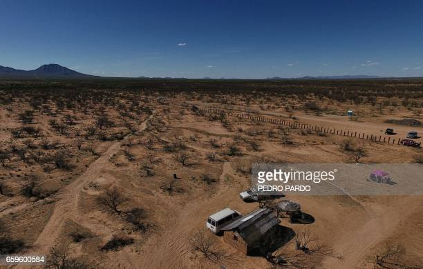 View of the metal fence along the border between the Altar desert in Mexico and the Arizona desert in the United States on March 25 in Sonora...