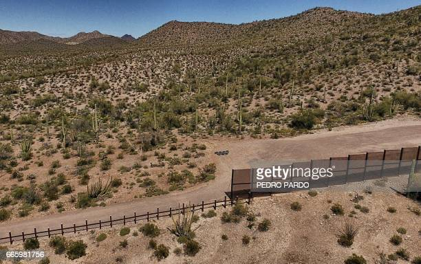 View of the metal fence along the border in Sonoyta Sonora state northern Mexico between the Altar desert in Mexico and the Arizona desert in the...
