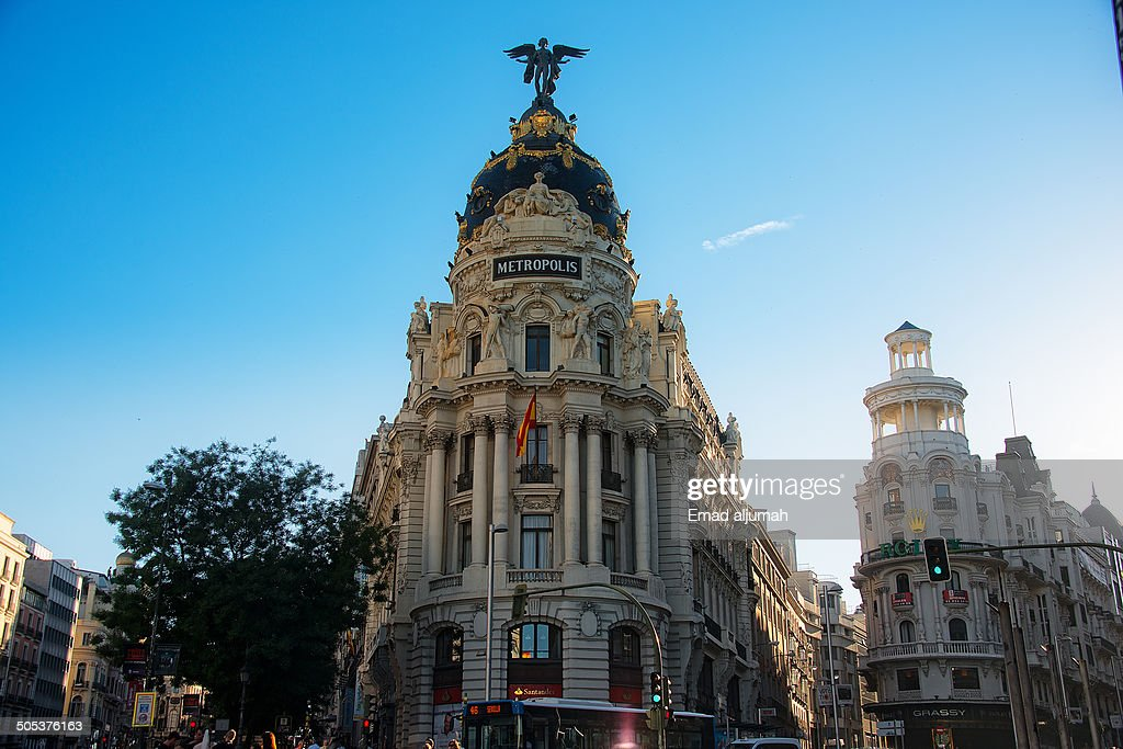 CONTENT] View of the Metropolis Building in Madrid at the corner of the Calle de Alcalá and Gran Vía.