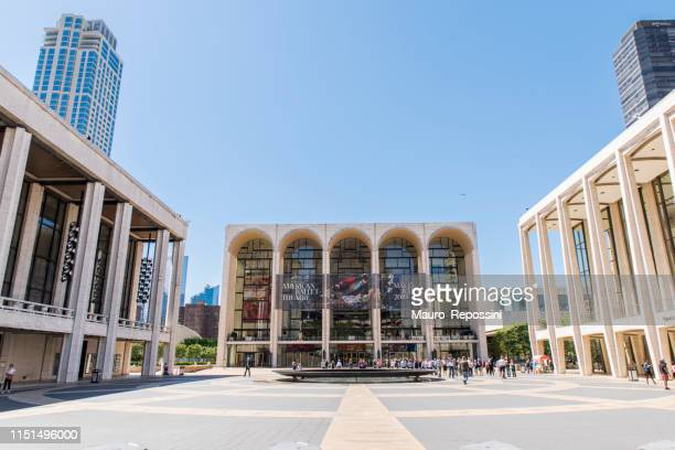 view of the metropolitan opera house in the lincoln center at upper west side manhattan, new york city, usa. - the theater lincoln center stock pictures, royalty-free photos & images