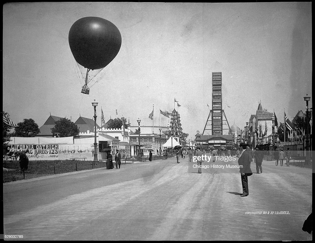 View of the Midway Plaisance at the World's Columbian Exposition world's fair, Chicago, Illinois, 1893. View includes the Ferris Wheel and captive balloon.